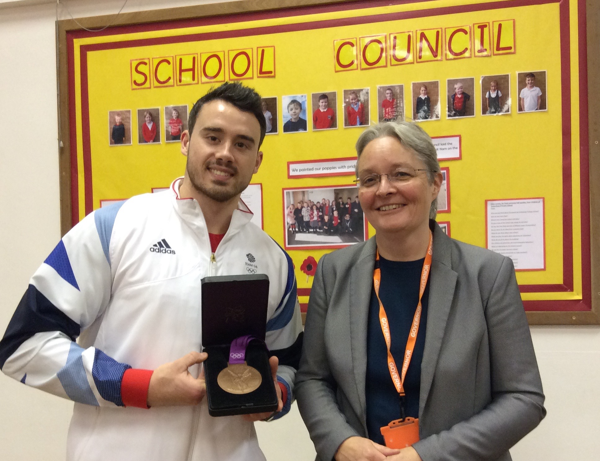 Olympic medallist Kristian Thomas with Cottenham Primary School Governor Sue Arnold