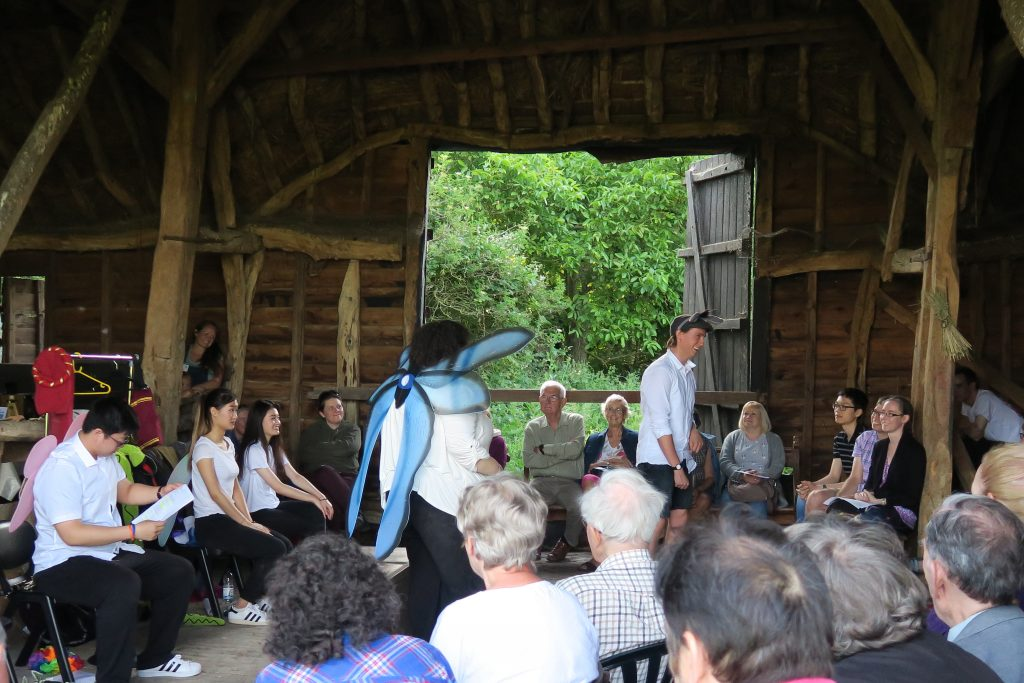 People watching Shakespear performance at the Tithe Barn