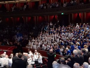 Mr Chilcott conductor joining audience to give children a standing ovation